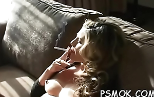 Irresistible sweetheart smokin'_ a cigarette naked in armchair