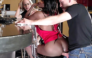 Diamond Jackson casually chats with Simone Sonay while the bartender fucks her bore