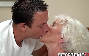 Short hair grandma teases with heavy tits in the lead banging